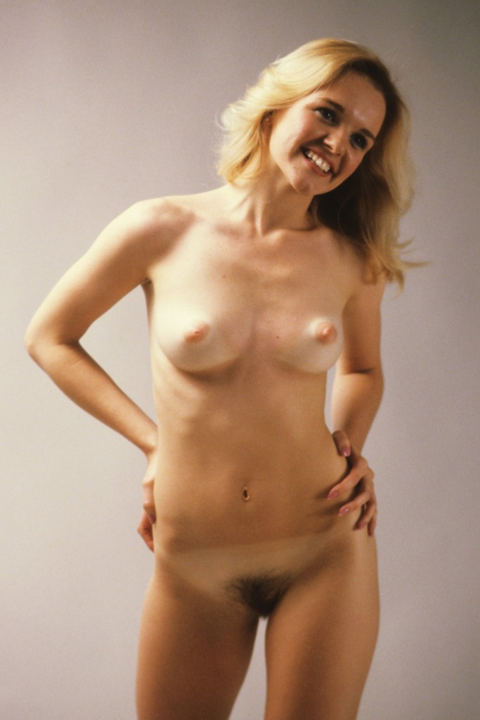 Nude blond girl with a pretty smile