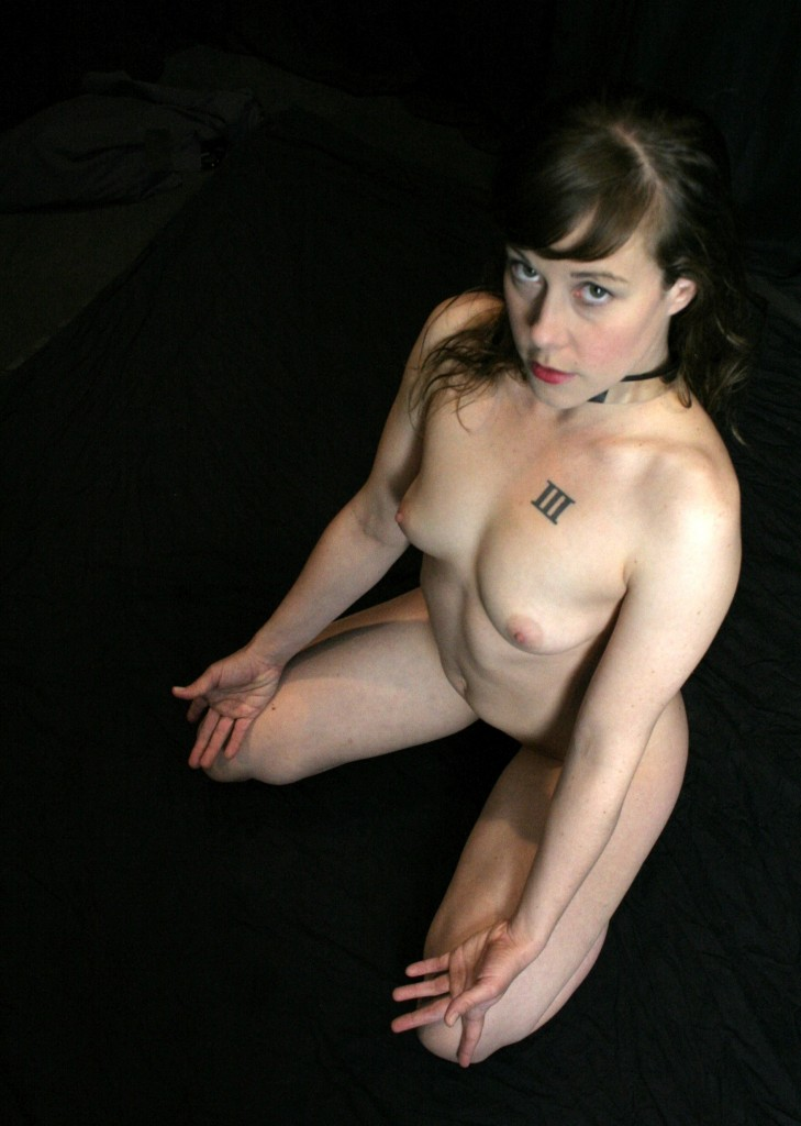 Collared kneeling Gorean slave girl
