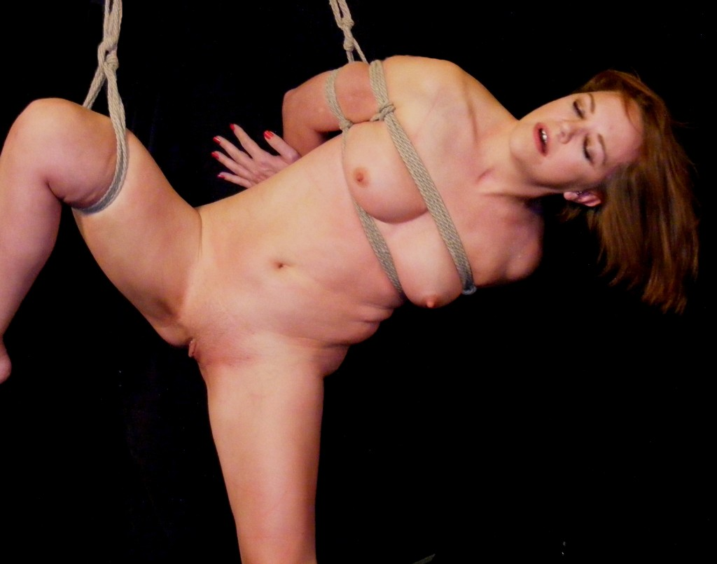 Nude girl, tied with her legs spread