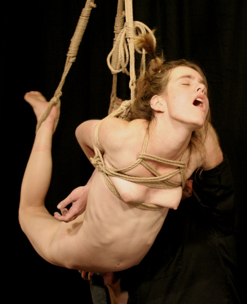 Naked girl in suspension bondage being masturbated with vibrator