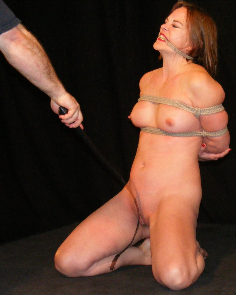 naked girl being whipped