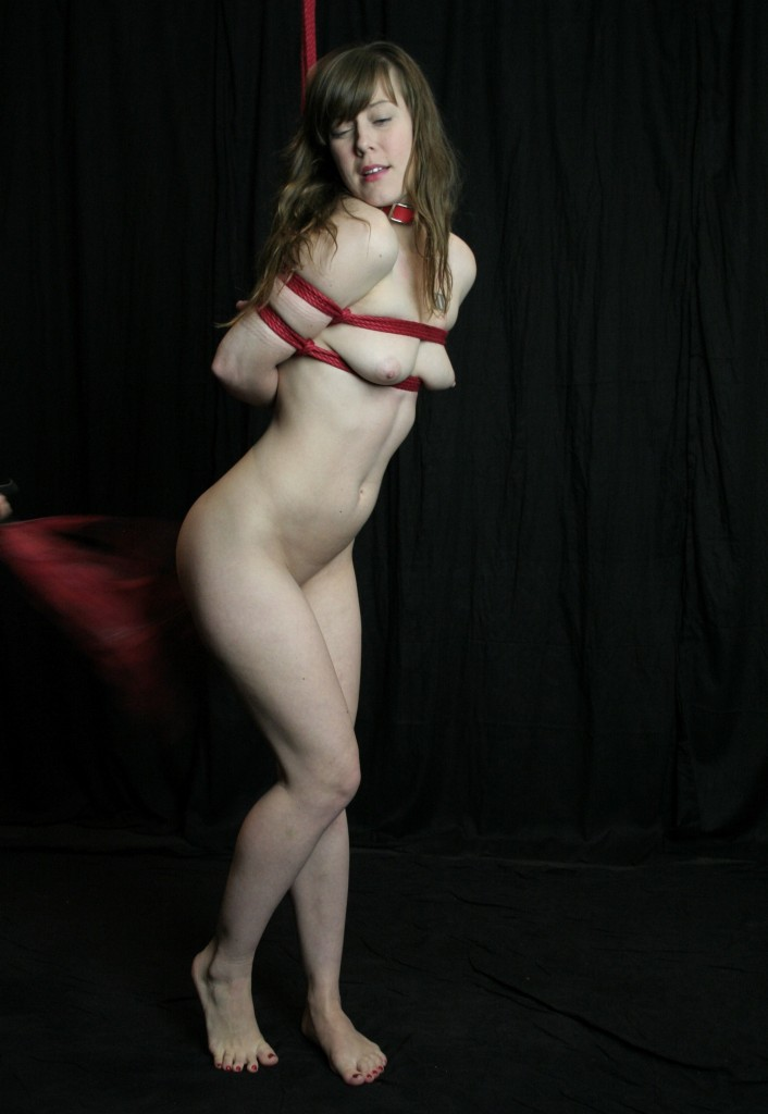 Nude bound Gorean slave girl being whipped