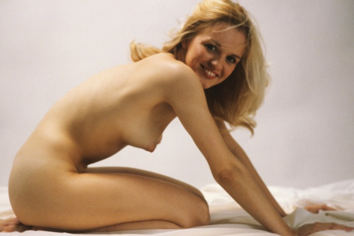 Kneeling nude blond girl