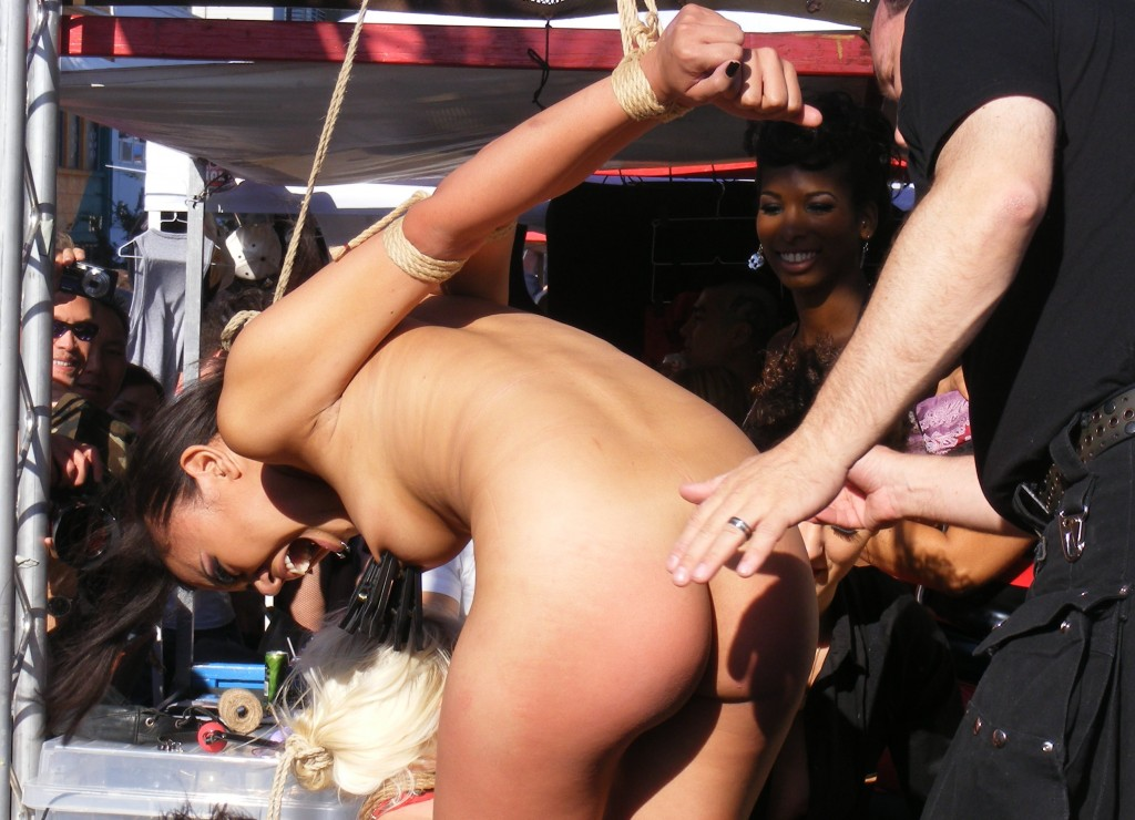 Nude girl tied in public with nipple and ass being tormented