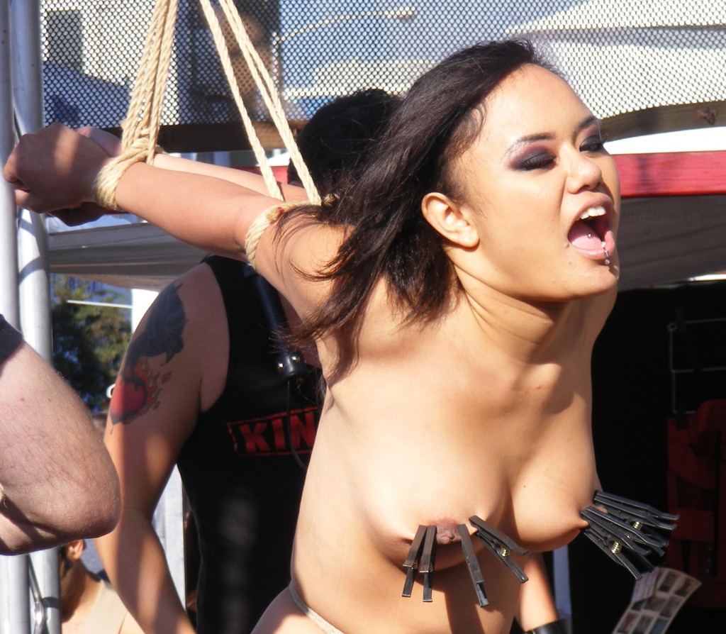 Annie Cruz nude and bound in public with her tits being tortured with clothes pegs