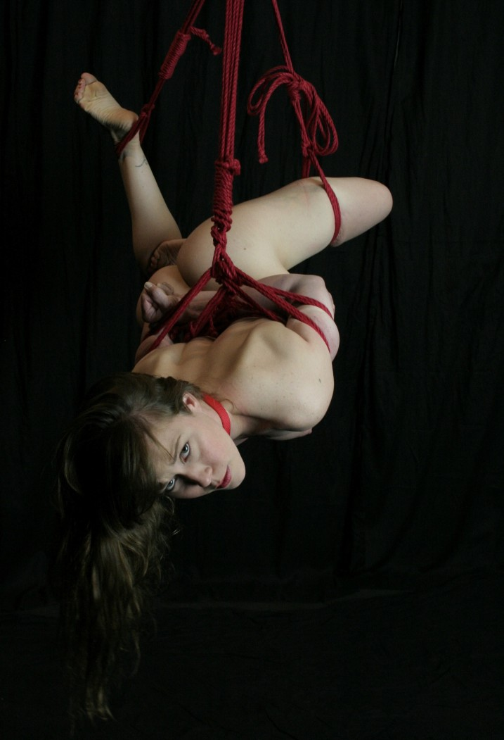 Naked gorean slave girl in suspension bondage