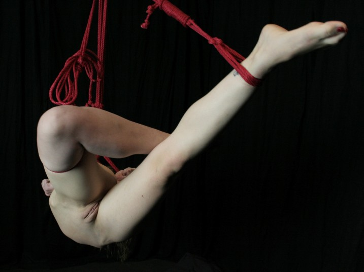 Nude slave girl in shibari suspension bondage