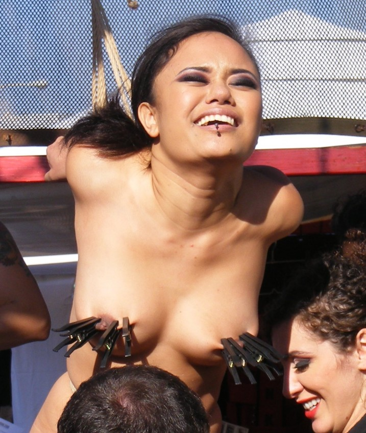 Naked slave girl in public bondage - Annie Cruz at Folsom Street Fair