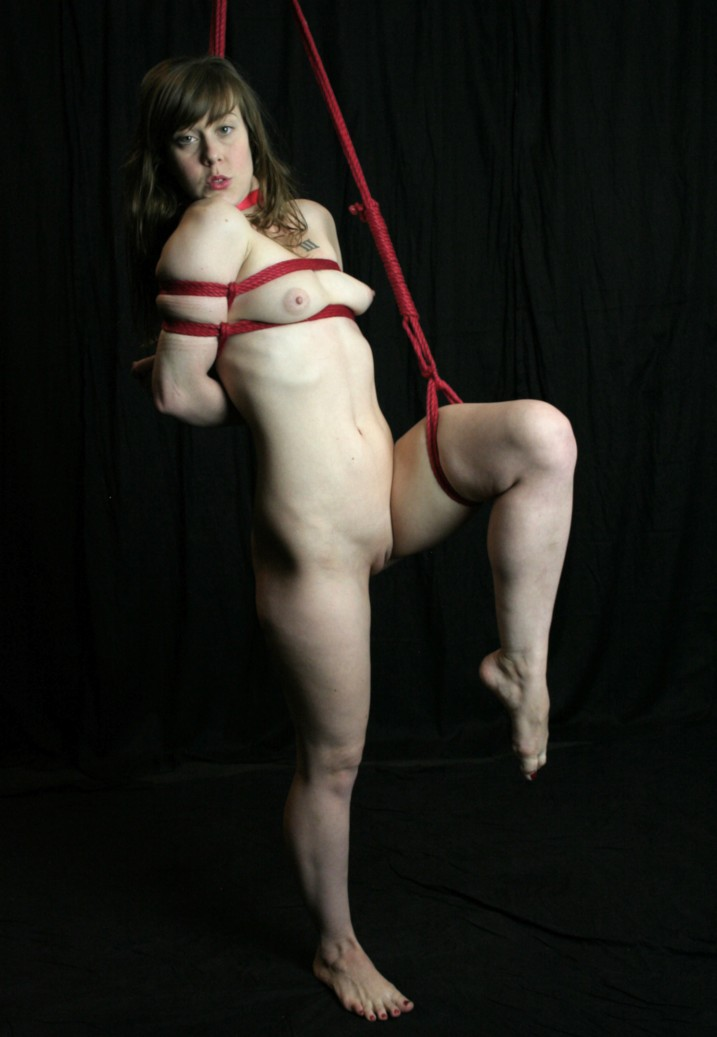 Naked Gorean Kajira in bondage with legs spread