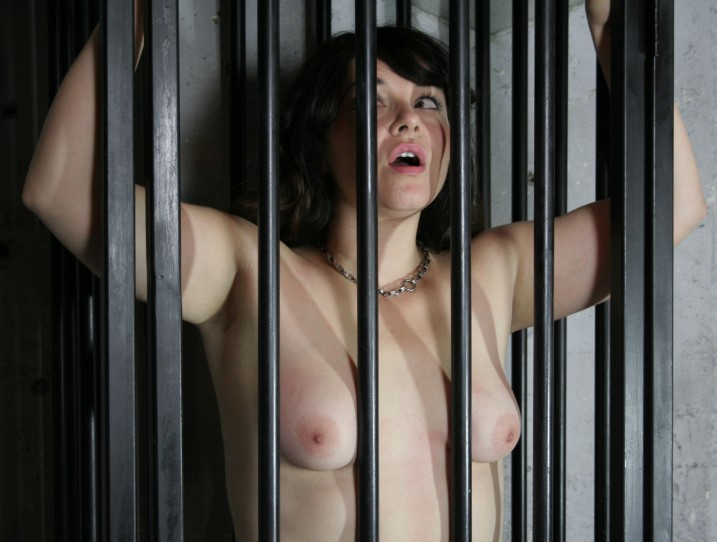 Nude girl behind bars