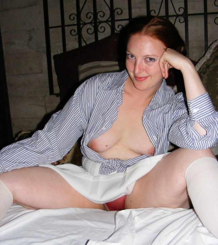 Redhead with open shirt showing tits and red panties upskirt.