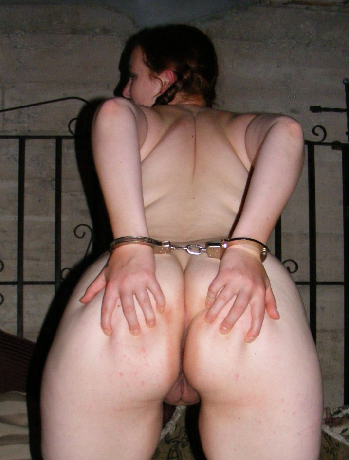 Nked girl in handcuffs ordered to spread ass cheeks