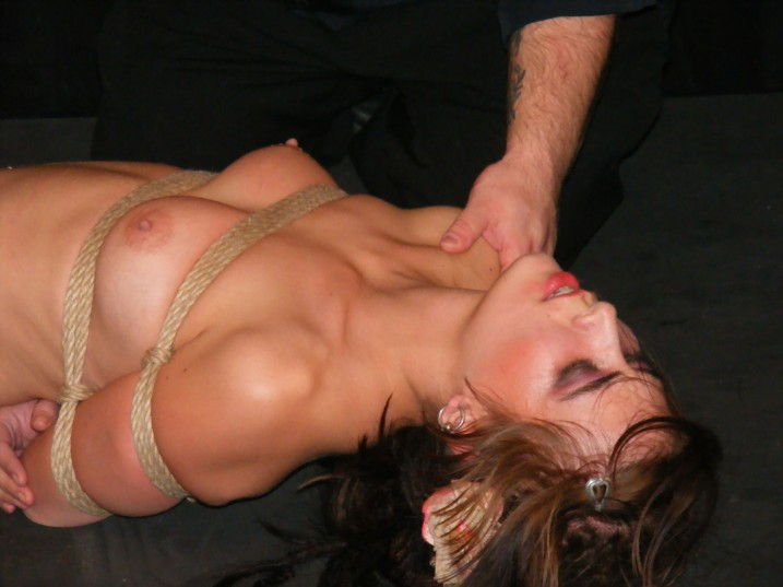Bound nude slave girl being fondled by her owner